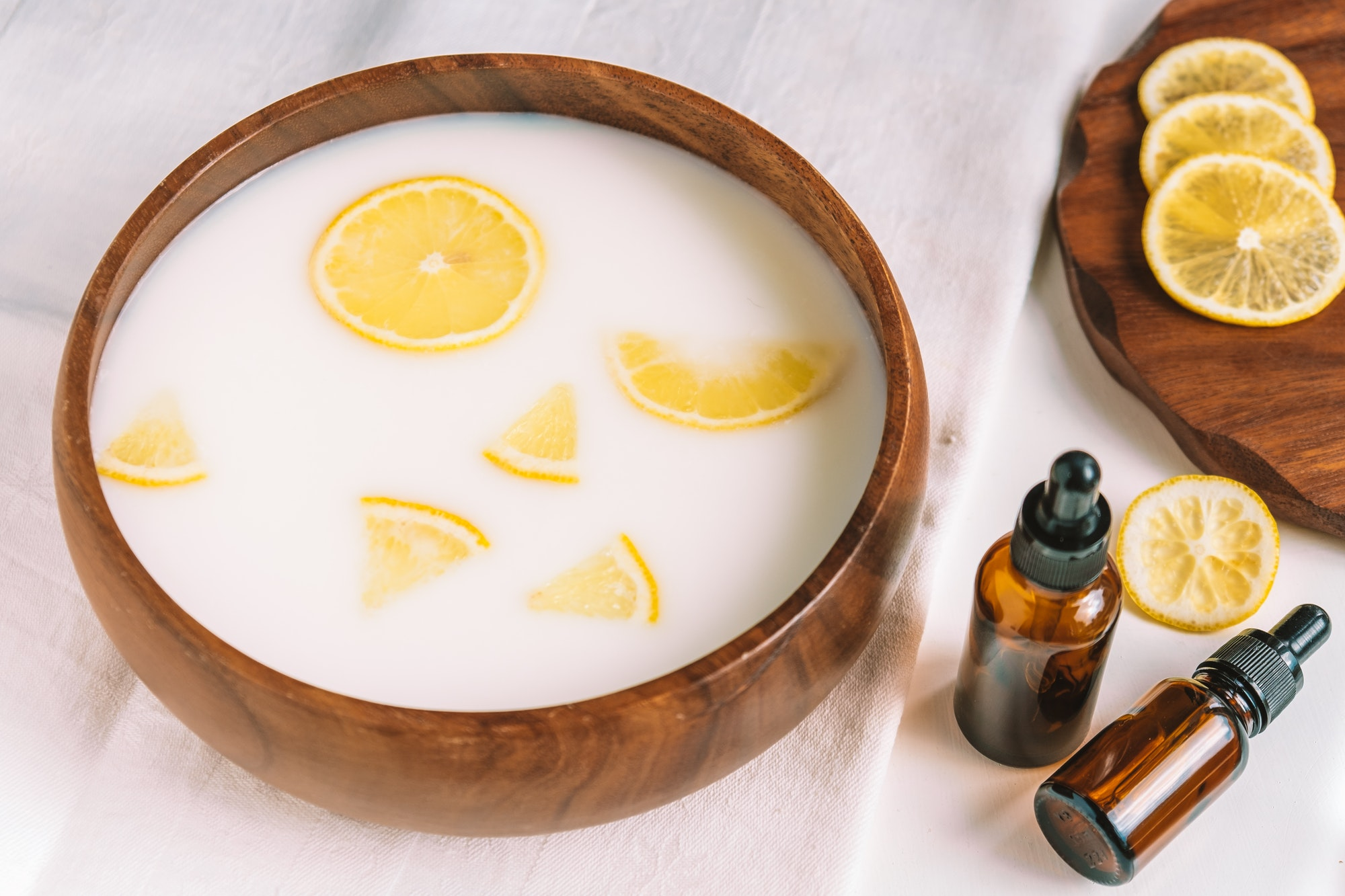 A bowl with milk and lemon slices for hand skin care. Softening and whitening.
