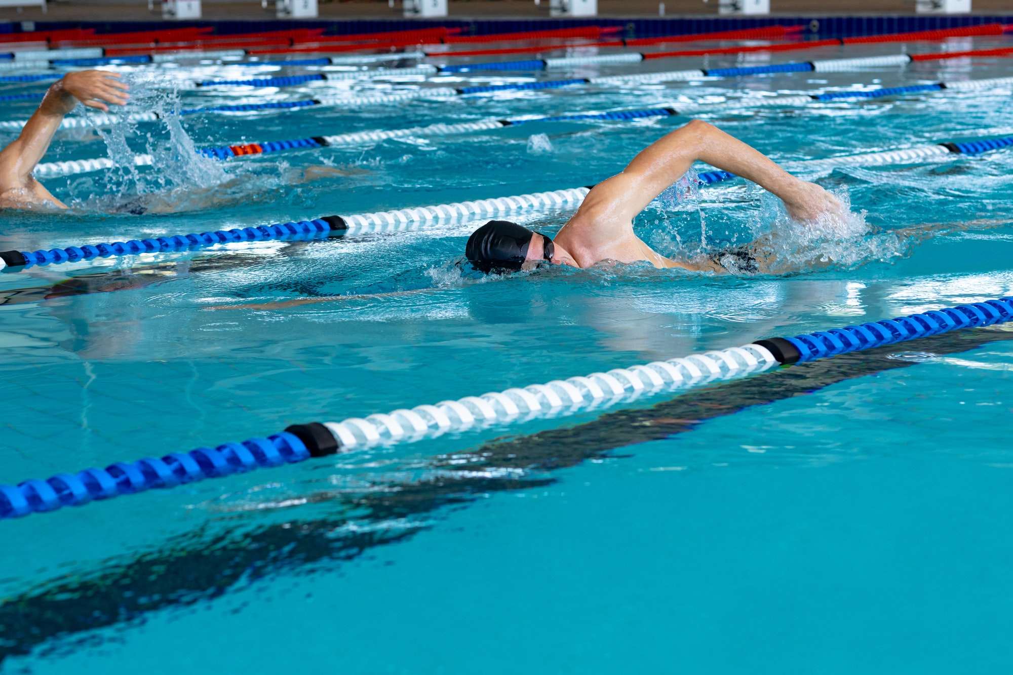 Swimmers swimming in the pool